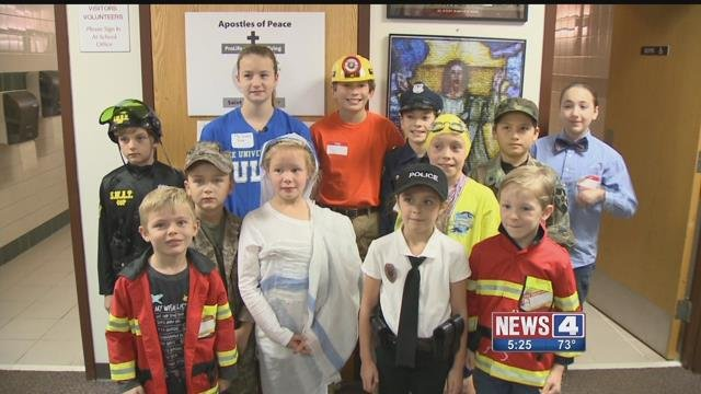 Students at St. Justin Martyr Elementary dressed up to help the organization Tiny Super Heroes, which sends capes to disabled sick children. Credit: KMOV