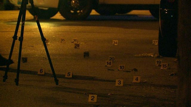 Evidence markers in the 3400 block of Louisiana (Credit: KMOV)