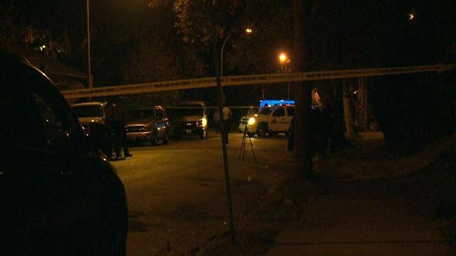 Investigators on the scene after a double shooting in the 3400 block of Louisiana (Credit: KMOV)