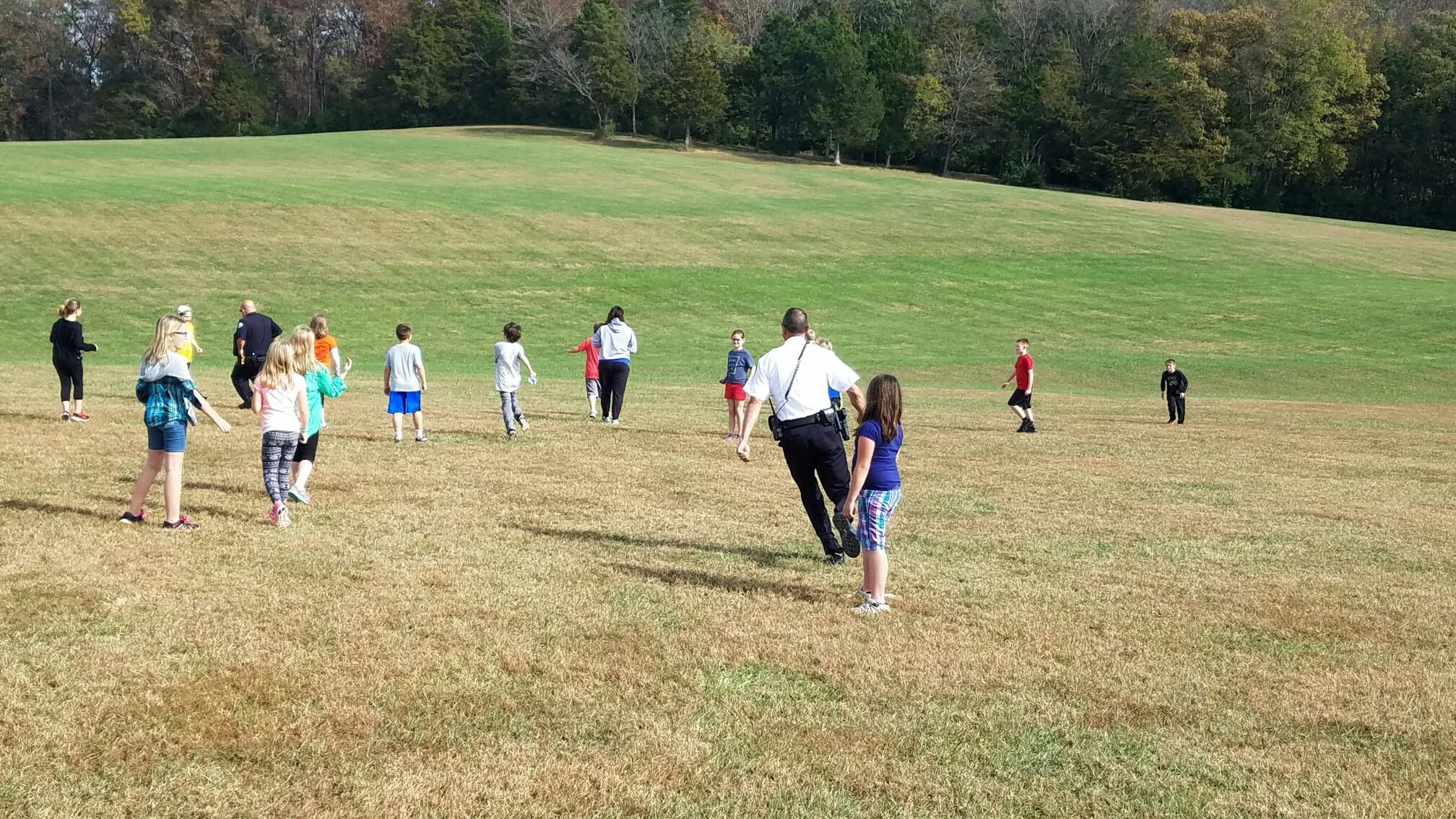 Washington, MO police officers play kickball with 4th grade students at Washington West Elementary School.