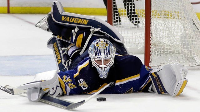 St. Louis Blues goalie Jake Allen dives for the puck during the third period of an NHL hockey game against Detroit Red Wings, Thursday, Oct. 27, 2016, in St. Louis. (AP Photo/Jeff Roberson)