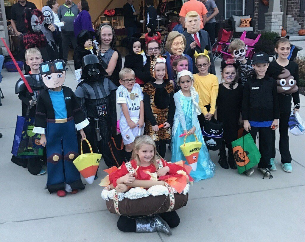 A group of children in Festus waiting for the storm sirens to go off to announce the start of trick or treating on Halloween.