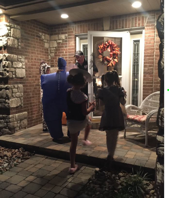 Children trick or treating in Festus where storm sirens are sounded to mark the beginning and end of trick or treating.