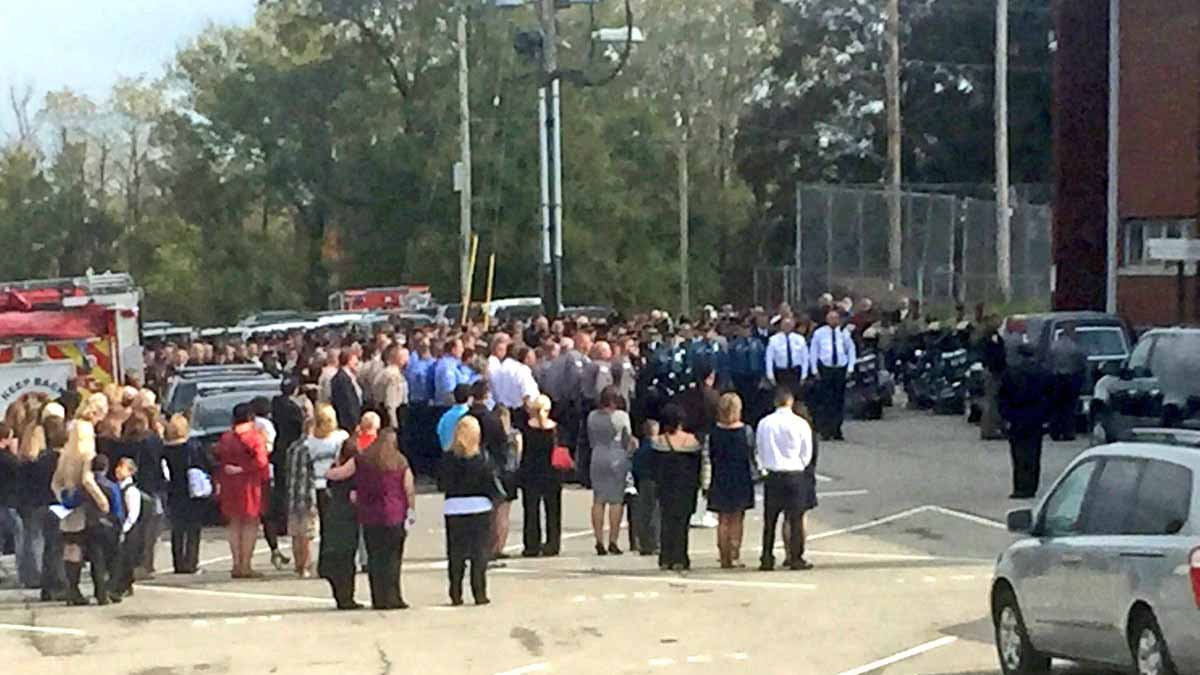People gathered in the streets of Chester, Illinois for the funeral procession of Officer James Brockmeyer. Credit: KMOV