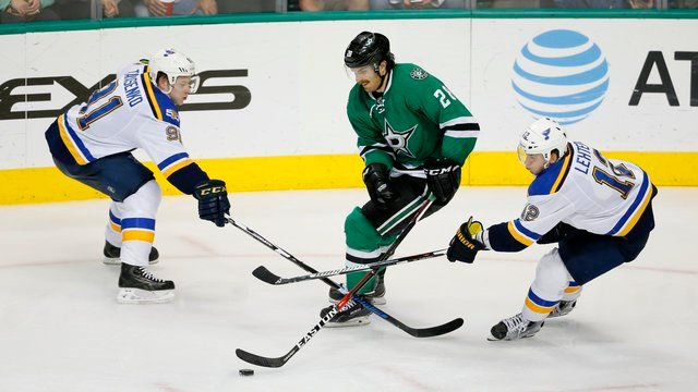 Dallas Stars defenseman Stephen Johns breaks his stick competing for the puck against St. Louis Blues' Vladimir Tarasenko and Jori Lehtera in the third period of an NHL hockey game, Thursday, Nov. 3, 2016, in Dallas. (AP Photo/Tony Gutierrez)