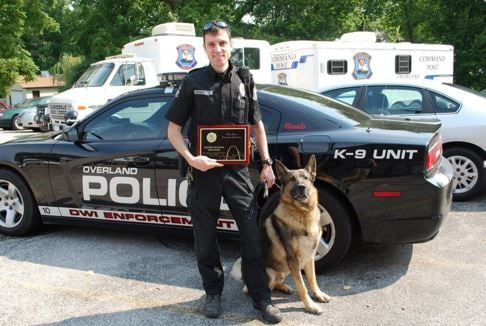 Diablo and his handler Officer Chris Fanning. (Credit: Overland Police Department)