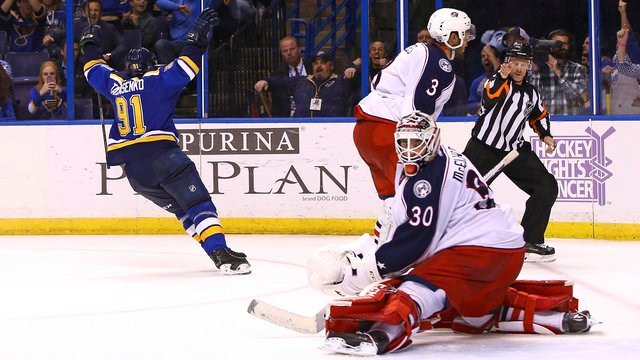St. Louis Blues' Vladimir Tarasenko, left, celebrates after scoring against Columbus Blue Jackets goalie Curtis McElhinney during overtime period of an NHL hockey game Saturday, Nov. 5, 2016, in St. Louis. The Blues won 2-1. (AP Photo/Billy Hurst)