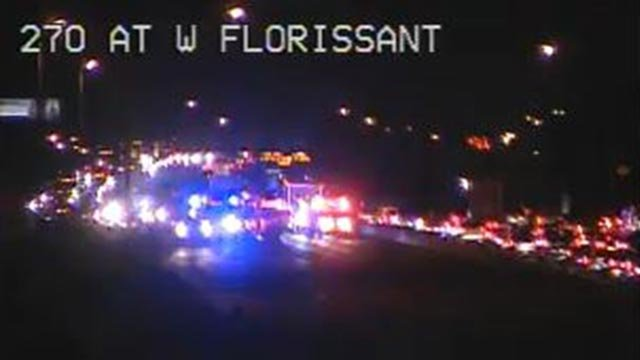 Emergency vehicles on EB I-270 at W. Florissant Monday (Credit: MoDOT)