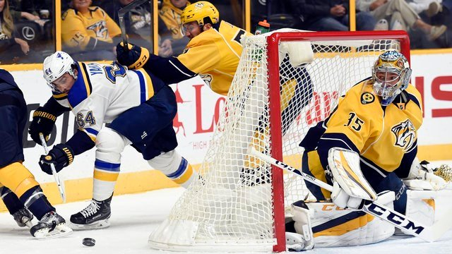 St. Louis Blues right wing Nail Yakupov and Nashville Predators defenseman Roman Josi chase down the puck behind goalie Pekka Rinne during the first period of an NHL hockey game Thursday, Nov. 10, 2016, in Nashville. (AP Photo/Mark Zaleski)