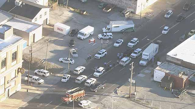 Two suspects were arrested after a stolen car was followed by police to an intersection near the Stan Musial Veteran's Memorial Bridge. Credit: KMOV