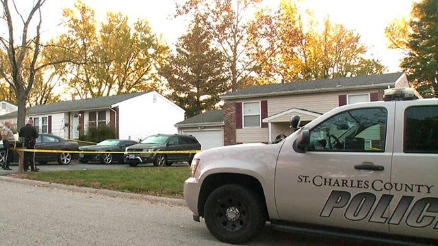 Officers outside home in St. Charles County after shooting (Credit: KMOV)