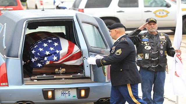A serviceman closes door to a hearse which contains remains of Corporal Donald Matney (Photo by Bill Greenblatt/UPI)