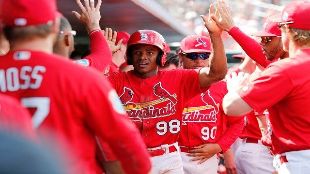 St. Louis Cardinals' Magneuris Sierra, center, high fives his teammates after scoring during the fifth inning of an exhibition spring training baseball game against the Atlanta Braves, Friday, March 11, 2016, in Jupiter, Fla. (AP Photo/Brynn Anderson)