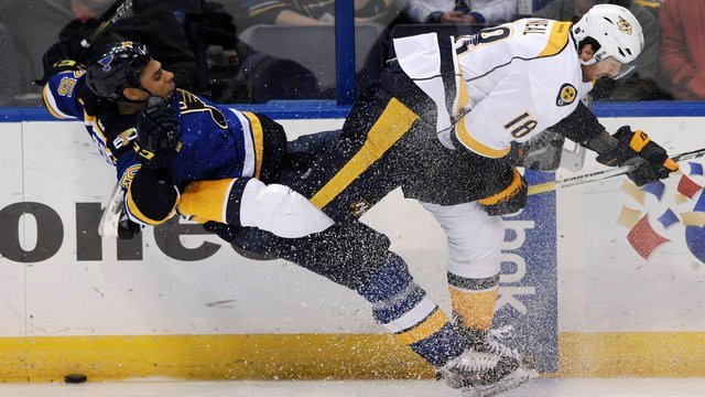 St. Louis Blues' Ryan Reaves, left, collides with Nashville Predators' James Neal (18) during the third period of an NHL hockey game, Nov. 19, 2016, in St. Louis. The Blues won 3-1. (AP Photo/Bill Boyce)
