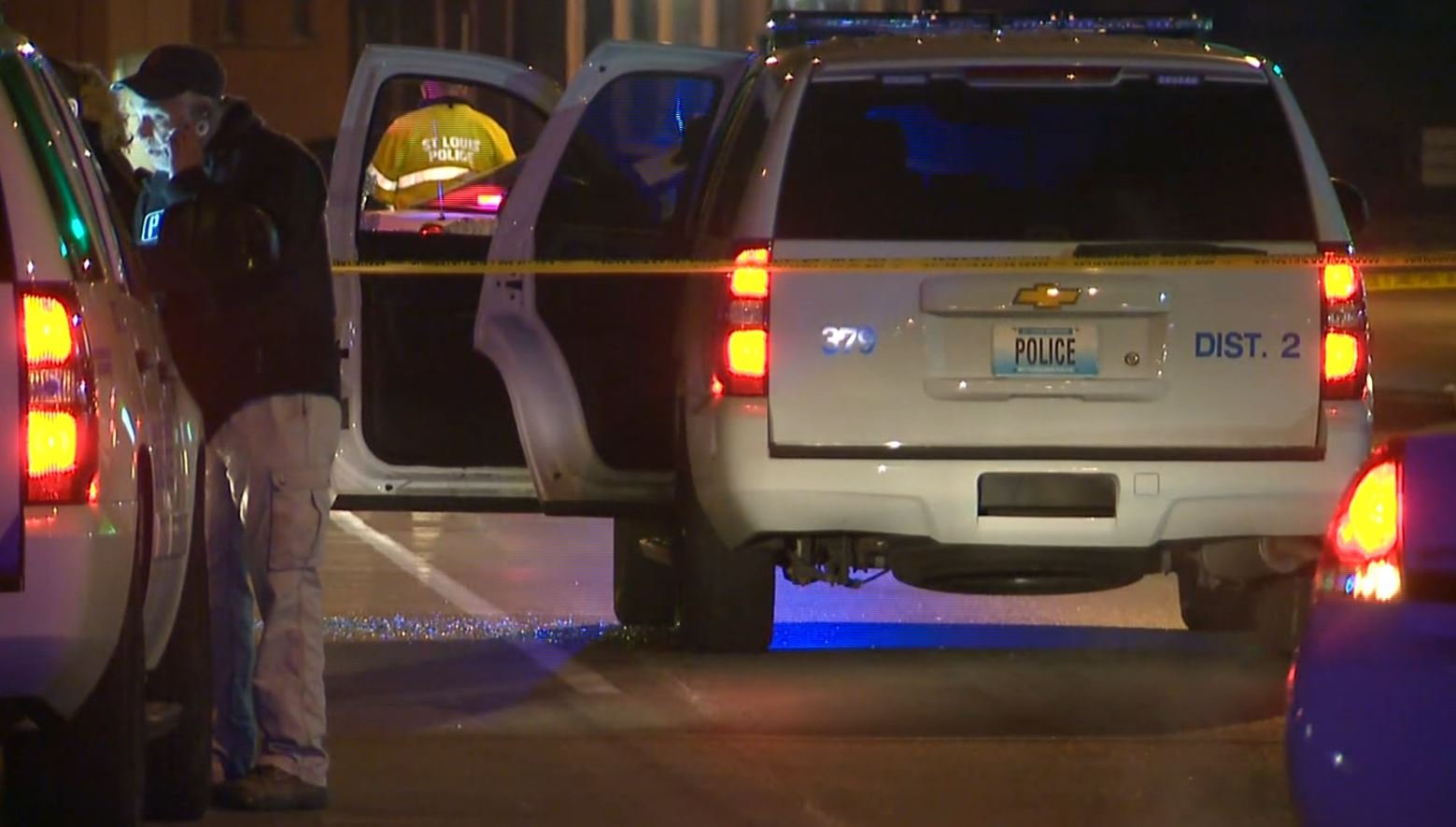 The officer's patrol car, with shattered glass on the road located at Hampton and Pernod. (KMOV)