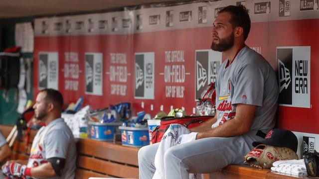 St. Louis Cardinals starting pitcher Michael Wacha sits in the dugout in the second inning of a baseball game against the Cincinnati Reds, Wednesday, Aug. 3, 2016, in Cincinnati. The Cardinals won 5-4. (AP Photo/John Minchillo)