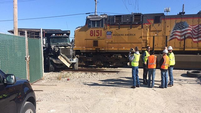 A truck was struck by a train while crossing at Buchanan Monday (Credit: Russell Kinsaul / News 4)
