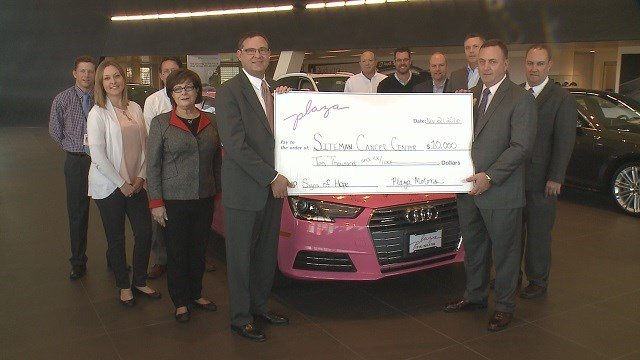 Plaza Motors donated a $10,000 check to Siteman Cancer Center on Monday. (Credit: KMOV)