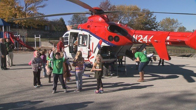 Students at Kennerly Elementary School get an up close look at a Cardinal Glennon helicopter. (Credit: KMOV)
