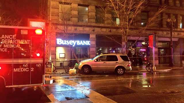 A man was shot in the head during an attempted robbery in downtown St. Louis Tuesday night. His car then crashed at 9th and Olive. Credit: KMOV