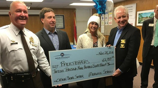 Students in the Mehlville School District raised nearly $13,000 for Backstoppers in honor of Officer Blake Snyder. (Credit: KMOV).