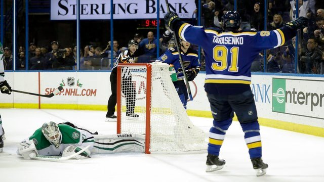 St. Louis Blues' Vladimir Tarasenko (91), of Russia, celebrates after scoring a goal past Dallas Stars goalie Antti Niemi, left, of Finland, during overtime of an NHL hockey game Monday, Nov. 28, 2016, in St. Louis. (AP Photo/Jeff Roberson)