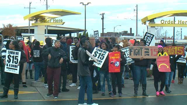 Protesters with the 'Fight for 15 Movemenr' protest outside a McDonalds in downtown St. Louis on Tuesday, Nov. 29. Credit: KMOV