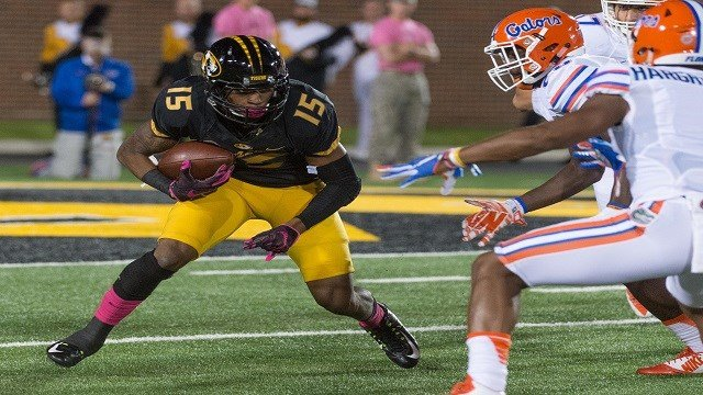 Missouri wide receiver Keyon Dilosa looks for running room before he is tackled during the first half of an NCAA college football game against Missouri, Saturday, Oct. 10 2015, in Columbia, Mo. (AP Photo/L.G. Patterson)