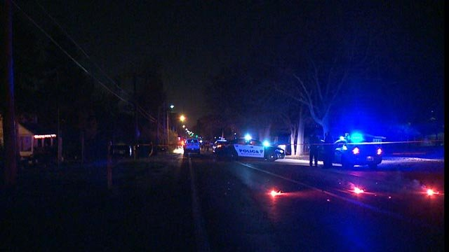 Investigators on scene after a fatal shooting at Bellefontaine Road and Gabriel (Credit: KMOV)