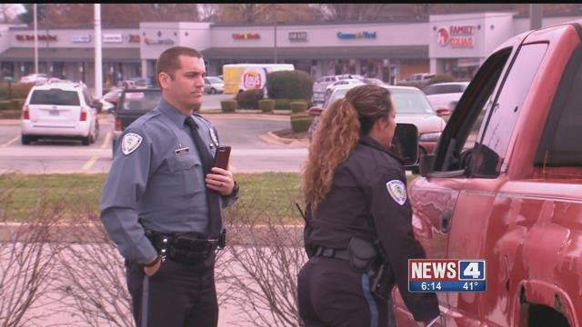 To spread holiday cheer, the Florissant polcie deaprtment gave out gift cards instead of tickets to drivers. Credit: KMOV