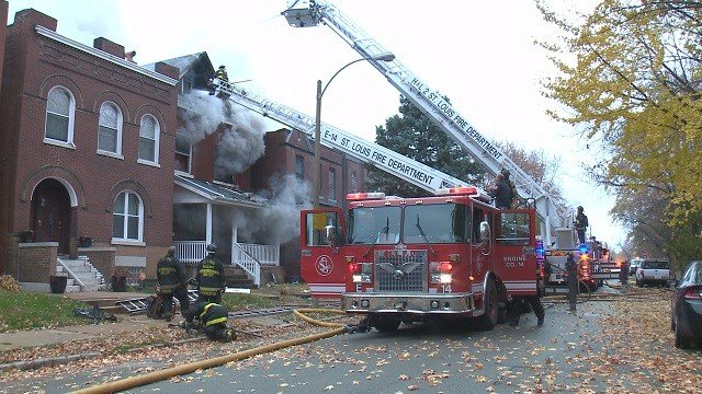 Two firefighters transported to local hospitals after putting out three story house fire. (Credit: KMOV)