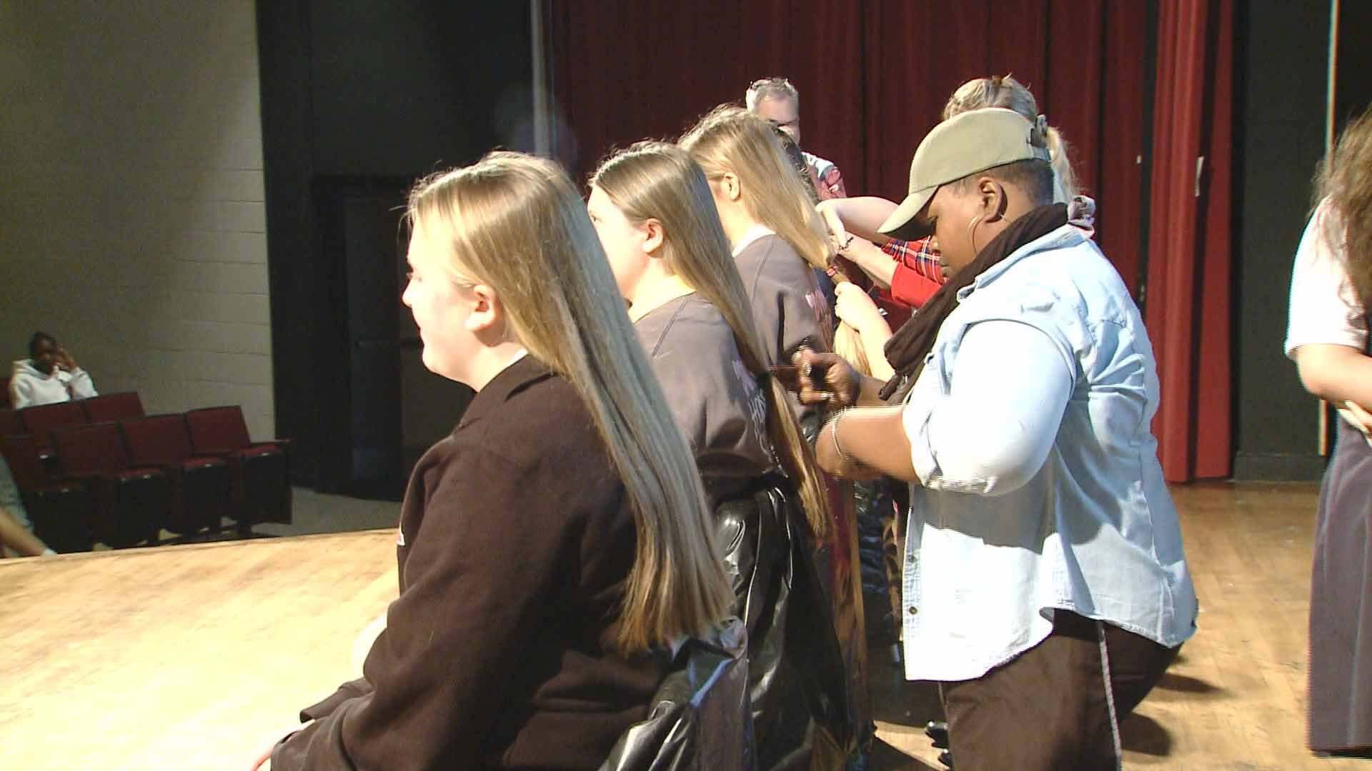 Students at Incarnate Word Academy volunteered to have their hair cut  so wigs can be made for cancer patients. Credit: KMOV