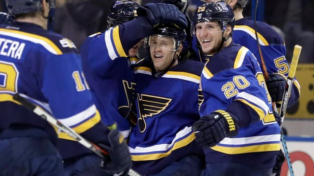 St. Louis Blues' Jaden Schwartz is surrounded by teammates including Alexander Steen after scoring the game-winning goal during overtime of an NHL hockey game against the Montreal Canadiens Tuesday, Dec. 6, 2016, in St. Louis. (AP Photo/Jeff Roberson)