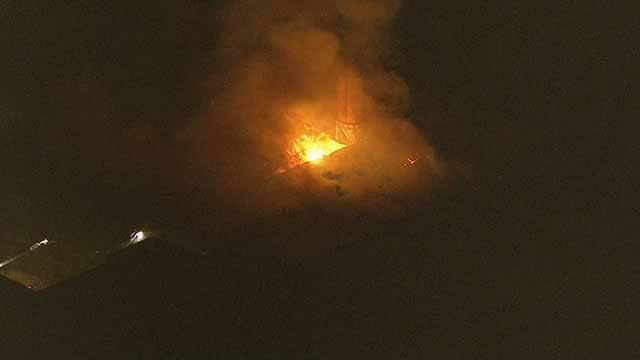 A fire broke out at an abandoned warehouse near intersection of Riverview and Scranton Thursday. Credit: KMOV