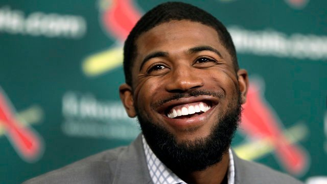 Dexter Fowler smiles during an introductory news conference announcing the free agent center fielder has signed with the St. Louis Cardinals, Friday, Dec. 9, 2016, in St. Louis. (AP Photo/Jeff Roberson)