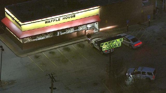 Police at the Waffle House following a Monday morning robbery (Credit: KMOV)
