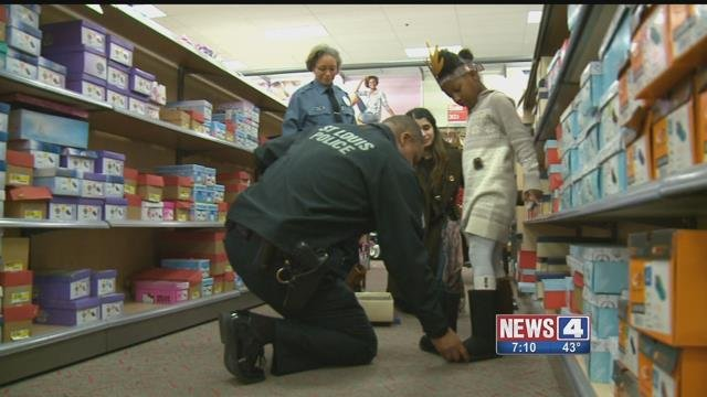 Police helping during 'Shop with a Cop' (Credit: KMOV)