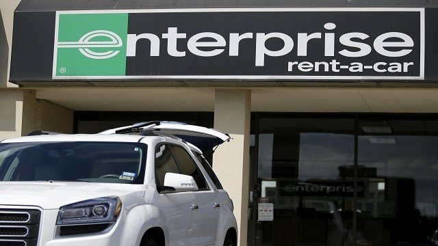A vehicle with its' rear tailgate opened sits parked in front of a Enterprise Rent-A-Carl location, Wednesday, Oct. 2, 2013, in Dallas. (Credit: AP Photo/ Tony Gutierrez)