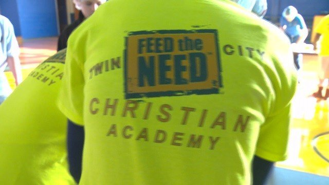 A group of students are working together to combat child hunger in Haiti & in St. Louis. (Credit: KMOV)
