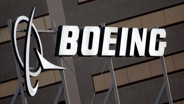 In this Jan. 25, 2011 file photo, the Boeing Company logo on the property in El Segundo, Calif. Boeing Co.  (Credit: AP Photo / Reed Saxon, File)
