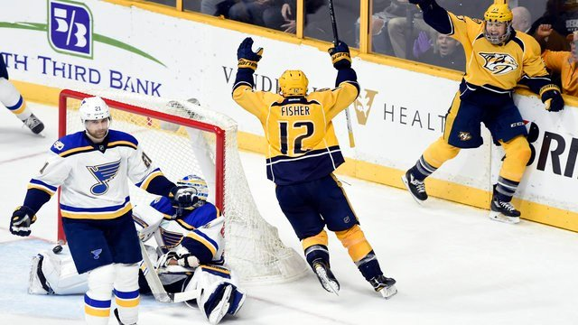 Nashville Predators center Mike Fisher and left wing Colin Wilson celebrate after Fisher scored the go-ahead goal against the St. Louis Blues during the third period of an NHL hockey game Tuesday, Dec. 13, 2016, in Nashville, Tenn. (AP Photo/Mark Zaleski)