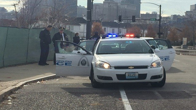 An officer fired one shot through his passenger-side window at a suspect driving a stolen car Wednesday morning in downtown St. Louis (Kelly Davis, KMOV)