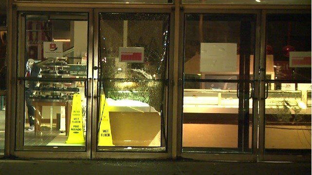 Glass is shattered at the Macy's department store in Alton, Illinois (Credit: KMOV)