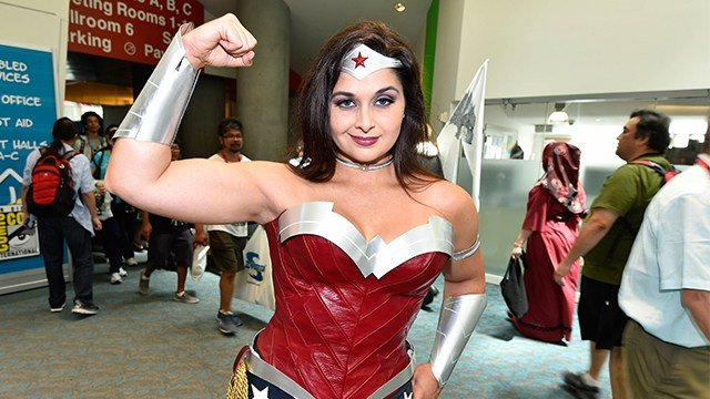 A woman dressed as Wonder Woman poses for a photo at the convention center on day 1 of the 2014 Comic-Con International Convention held Thursday, July 24, 2014 in San Diego. (Photo by Denis Poroy/Invision/AP)