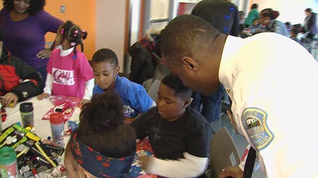 Ferguson officers brought holiday cheer to kids during Shop with a Cop. Credit: KMOV