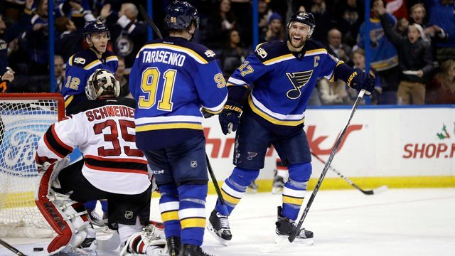 St. Louis Blues' Alex Pietrangelo (27) smiles after scoring past New Jersey Devils goalie Cory Schneider during the second period of an NHL hockey game Thursday, Dec. 15, 2016, in St. Louis. (AP Photo/Jeff Roberson)