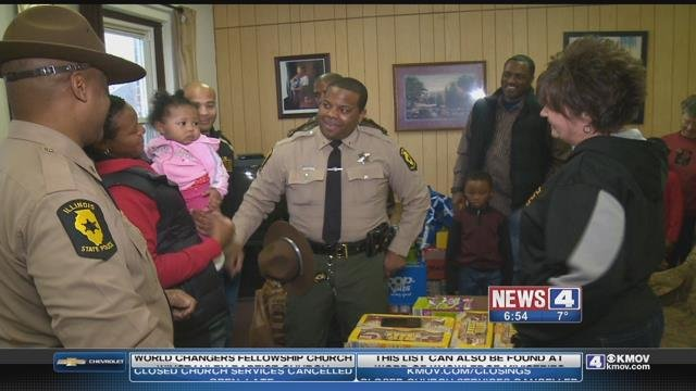 Illinois State Police troopers delivered gifts to a Metro East shelter. (Credit: KMOV).