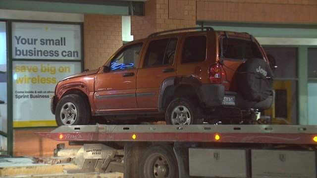 A stolen Jeep Liberty was used to crash through the front of the store on Clayton Road. (Credit: KMOV)