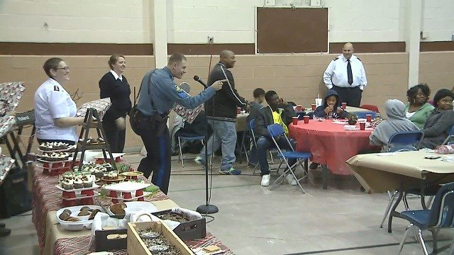 Officers from Missouri State Highway Patrol and Maplewood Police Department handed out presents for children at The Salvation Army. (Credit: KMOV)