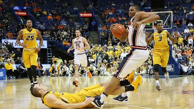 Illinois guard Malcolm Hill, right, is fouled by Missouri guard Cullen VanLeer in the second half on Wednesday, Dec. 21, 2016 during the annual Braggin' Rights Game between Missouri and Illinois at Scottrade Center in St. Louis, Mo. (Credit: Getty Images)